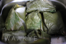 Waakye - rice and brown beans served in green leaves.