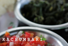 The way you would commonly find kachumbari: diced onions, tomatoes, and coriander.